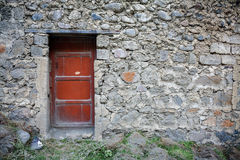 Old door in stone wall Stock Images