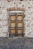 Old door in stone wall royalty free stock photos