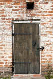 Old door in the stone walls of the village houses. Excellent background. Stock Photo