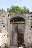 Old door in the stone walls of the village houses. Excellent background. Stock Image