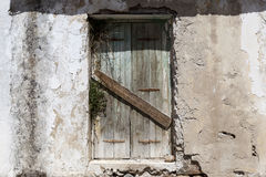 Old door in the stone walls of the village houses. Excellent background. Royalty Free Stock Photography