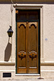 Old door and a street lamp in the centre of colonia Royalty Free Stock Photos