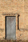 Old door studded with metal in an brick building Royalty Free Stock Photography