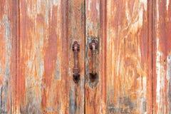 Old door texture. The old door texture with steel doors handles Royalty Free Stock Photography