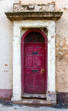 Old door to a derelict city building Royalty Free Stock Image