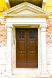 Old door to different concepts: restore, solution ,construction. At Venice, Italy Royalty Free Stock Images