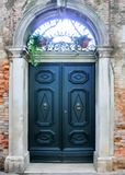 Old door to different concepts: restore, solution ,construction. At Venice, Italy Stock Photography