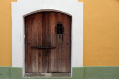 Old door. A door to one of the buildings of Castillo de San Cristóbal. San Juan, Puerto Rico Royalty Free Stock Image