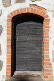 Old door. A door to an old stone building Royalty Free Stock Photography