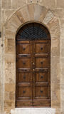 Old door,Tuscany,Italy. View of an old door of an ancient house in San Giminiano,Tuscany,Italy Stock Photo