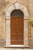 Old door,Tuscany,Italy. View of an old door of an ancient house in San Giminiano,Tuscany,Italy Royalty Free Stock Photos