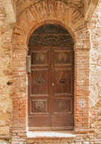 Old door,Tuscany,Italy. View of an old door of an ancient house in San Giminiano,Tuscany,Italy Stock Photography