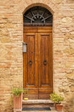 Old door,Tuscany,Italy. View of an old door of an ancient house in San Giminiano,Tuscany,Italy Stock Photos