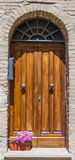 Old door,Tuscany,Italy. View of an old door of an ancient house in San Giminiano,Tuscany,Italy Stock Image