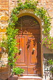 Old door,Tuscany,Italy. View of an old door of an ancient house in San Giminiano,Tuscany,Italy Stock Images