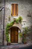 Old door in the Tuscany town of Assisi Stock Photography