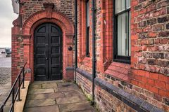 Old door United Kingdom. Wooden door entrance at old house at Liverpool, United Kingdom Royalty Free Stock Photos