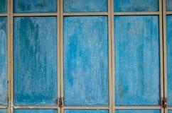 Old door. Vintage blue wooden door Stock Photos