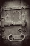 Old door. Vintage style sepia photo. Royalty Free Stock Photography