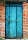 Old door and wall. Old blue door and wall Royalty Free Stock Photos