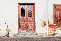 Old door on wall background Royalty Free Stock Images