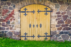 Old Door with wall and grass Royalty Free Stock Image