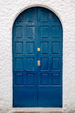 The old door on a white wall Stock Photography
