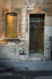 Old door and window. Old broken, damaged door and window on the classic building royalty free stock photo