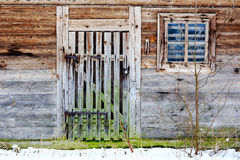 Old door and window of wooden building Stock Photo
