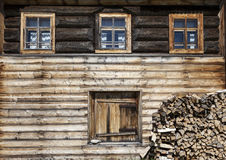 Old door and window on the wooden wall of a village house. Excellent background. Royalty Free Stock Image