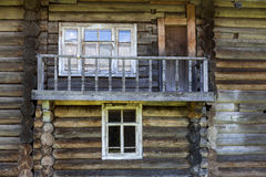 Old door and window on the wooden wall of a village house. Excellent background. Royalty Free Stock Images