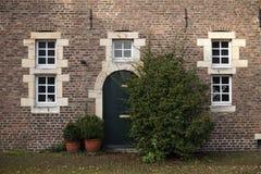 Old door and windows on courtyard Castle Hoensbroek Royalty Free Stock Images