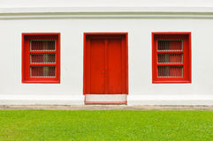 The old door and windows red on white wall Stock Photography