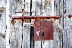 Free Old Door With Rusty Bolt, Lock. Rusted, Oxidized. Hinge. Old Wood. Royalty Free Stock Photography - 119937047