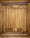 Old door of wood with patterns carved on it. Stock Photography