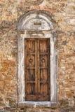 Old door. Old wooden door of a broken brick wall Royalty Free Stock Photo