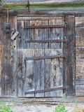 Old door in a wooden shed Royalty Free Stock Photography