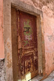 Old door. Old worn out door in a capital in Southern Europe Royalty Free Stock Photography