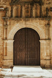 Old door with wrought iron decoration Stock Images