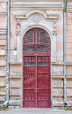 Old door with wrought-iron details. Red old door with wrought-iron details in Ivano-Frankivsk, Ukraine Royalty Free Stock Images
