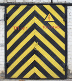 Old door with yellow and black stripe Stock Images