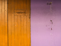 Old Door Yellow with Purple Wall Stock Photo