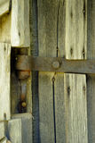 Old doorbell made of wood. The door of an old cellar Royalty Free Stock Images