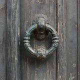 Old doorhandle on green wooden door stock photos