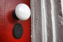 Old Doorknob on Antique Red Door of Historic Home Stock Photography
