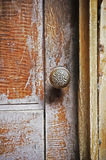 Old doorknob. An old weathered doorknob in an old house Stock Photo