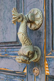 Old doorknocker in the form of a fish Stock Photography