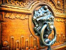 Old doorknocker. At a front door Stock Photo