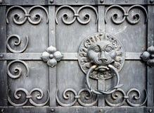 Old doorknocker. At a front door Stock Photography