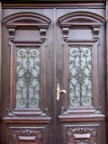 Old doors. Close-up of decorated wooden doors Royalty Free Stock Photo